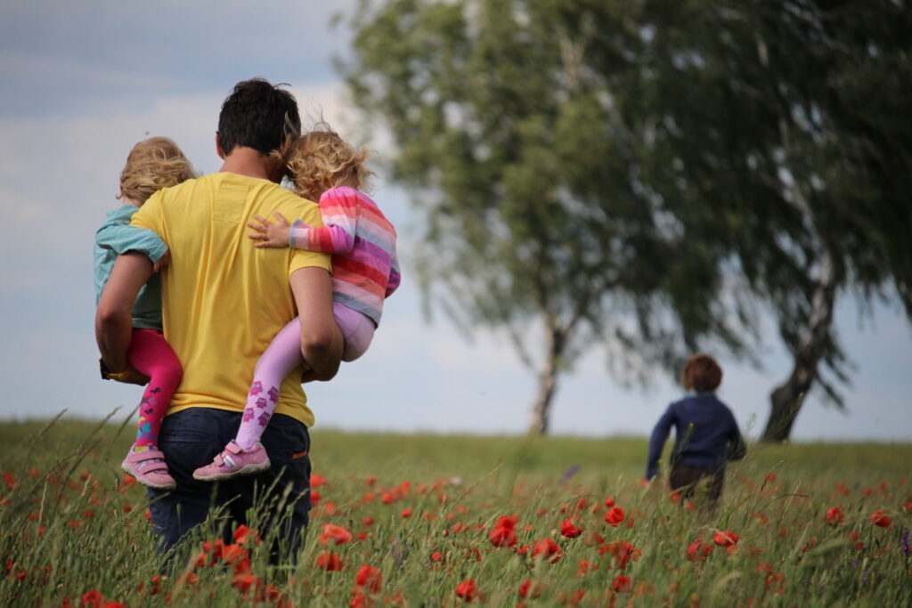 Dad with kids in field - What every kid needs to hear from their father