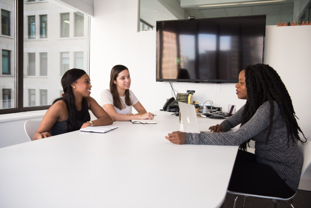 People interviewing.  - Preparing your kids for that first job interview