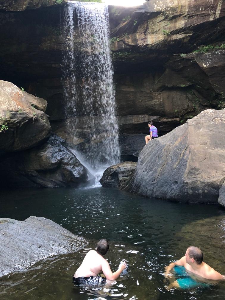 Take your kids camping Swimming below the falls