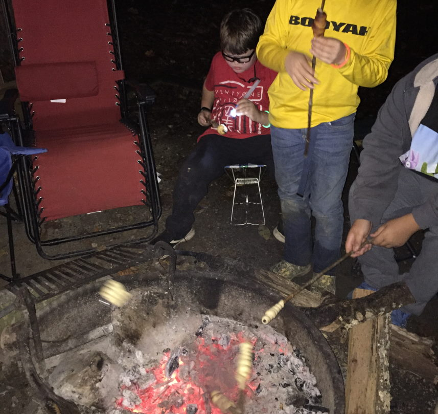 Parenting through the scout laws Scouts cooking around a fire