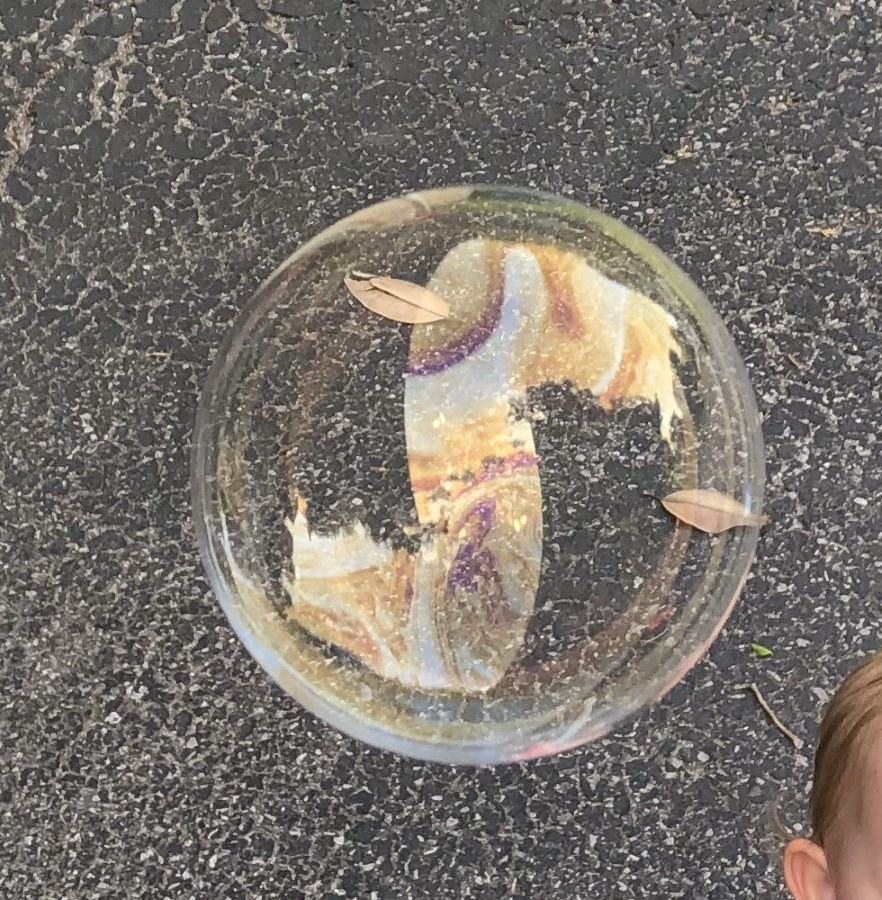 Toddlers love playing with bubbles