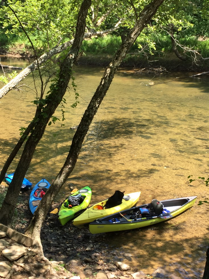 How to sleep better while camping Kayaks by the creek